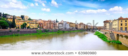 arno river waterfront evening reflections in florence stock photo © xbrchx