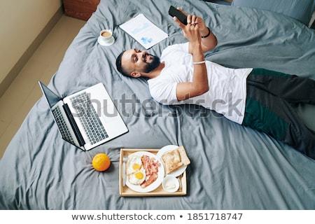 Cansado hombre cama no feliz almohada Foto stock © Lopolo