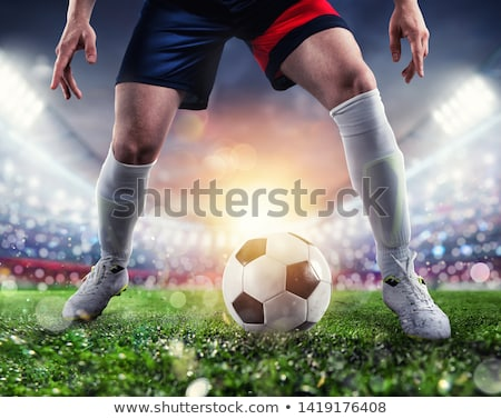 soccer players with soccerball at the stadium during the match stock photo © alphaspirit