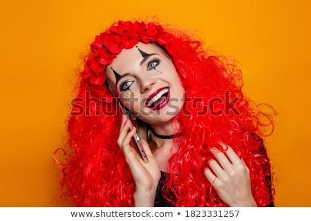 Mosolygó nő boszorkány beszél okostelefon izolált mosolyog Stock fotó © deandrobot