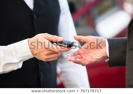 valets hand giving car key to man stock photo © andreypopov