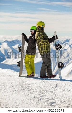 couple with snowboard in winter Stock photo © adrenalina