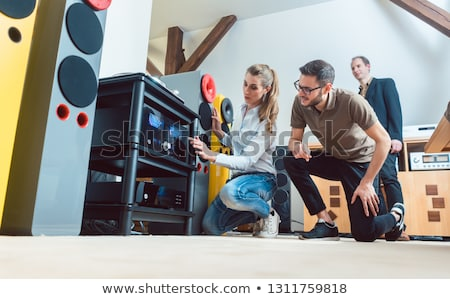 Young couple buying high-end stereo equipment in store Stock photo © Kzenon