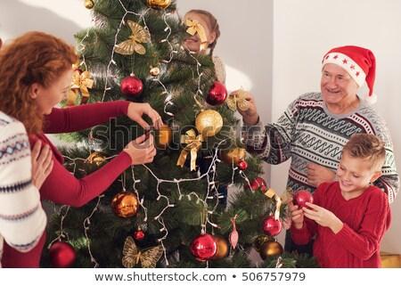 happy senior couple decorating christmas tree stock photo © dolgachov
