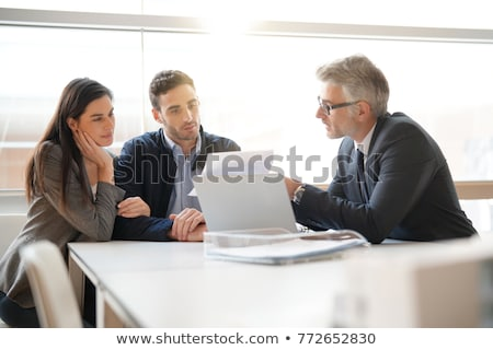 Advisor Sitting With Smiling Young Couple Stock photo © AndreyPopov