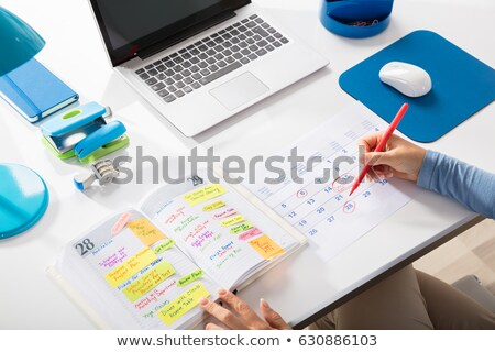businesswoman writing schedule in calendar diary stock photo © andreypopov