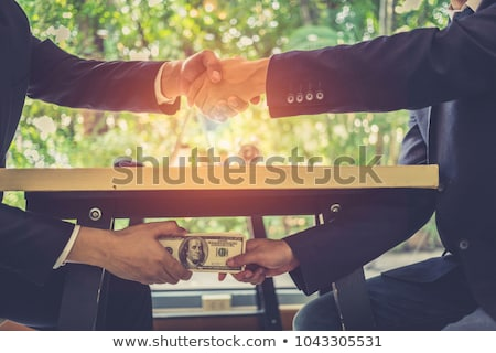 Stock photo: Bribe And Corruption Concept Corrupted Businessman Sealing The