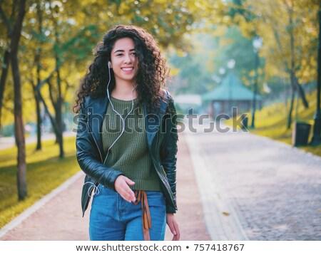 женщину · беспроводных · оратора · улыбаясь - Сток-фото © dashapetrenko