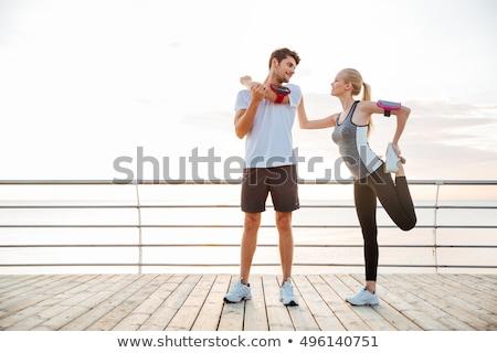 Stok fotoğraf: Gülen · çift · bacaklar · plaj · uygunluk