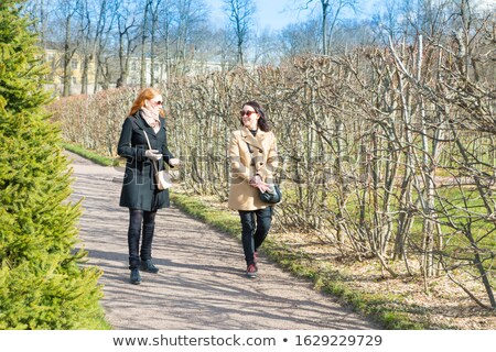 young girl in sunglasses walking in forest trees stock photo © robuart