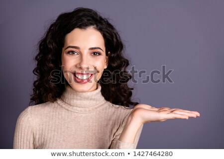 Young woman holding an invisible object smiling Stock photo © nyul