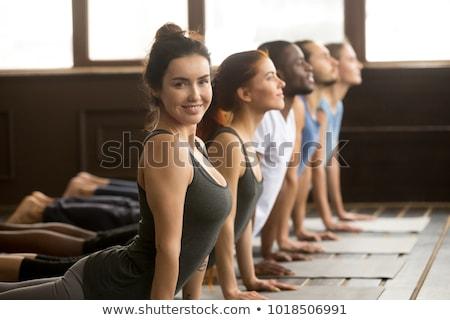 Yoga instructeur vrouwelijke oefening Stockfoto © Kzenon
