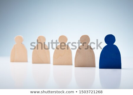 Figure Standing In Front Of Other Human Figures Over Desk Stock photo © AndreyPopov