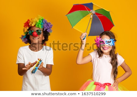 Children in carnival costumes on multicolor background. Stock photo © choreograph