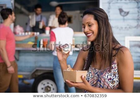 женщину сидят скамейке еды бизнеса Сток-фото © wavebreak_media