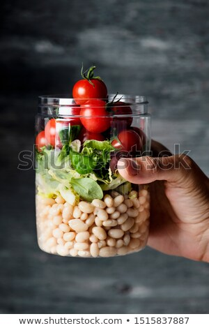 homem · pedreiro · jarra · salada · jovem - foto stock © nito