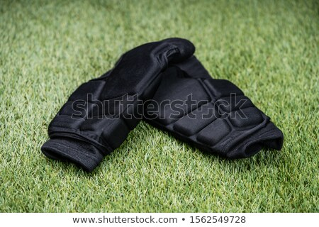 Black Shin Guards On Green Turf Background Stock photo © AndreyPopov