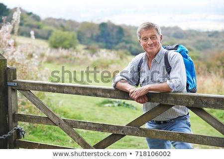 Senior uomo escursioni campagna uomini piedi Foto d'archivio © HighwayStarz