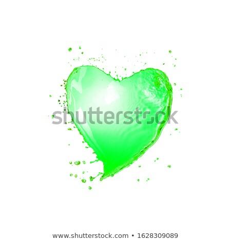 Petal of green shamrock as a drink's splash with drops. Stock photo © artjazz