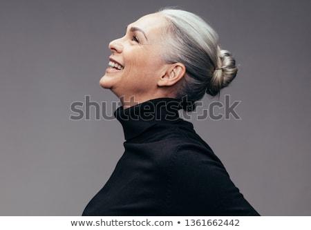 Sorridere capelli neri donna grigio muro moda Foto d'archivio © Lopolo