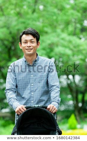 30 jaar oude man lopen park boom baby Stockfoto © Lopolo
