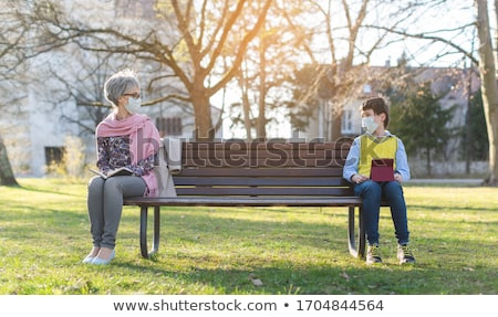 Grandmother and grandson separated by social distancing Stock photo © Kzenon