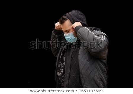 Man in hood with mask to protect him from Coronavirus. Corona virus pandemic. Young man with medical Stock photo © user_15523892