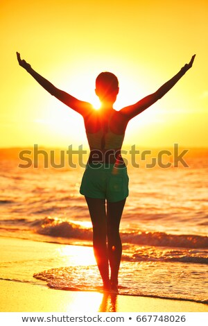 Wellness girl doing sun salutation morning yoga. Carefree person living a free life. Cheering woman  Stock photo © Maridav