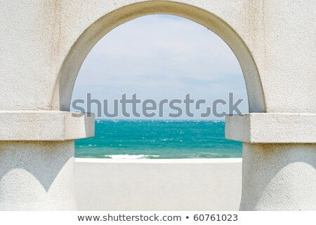 looking at the ocean through arch door Stock photo © Ansonstock