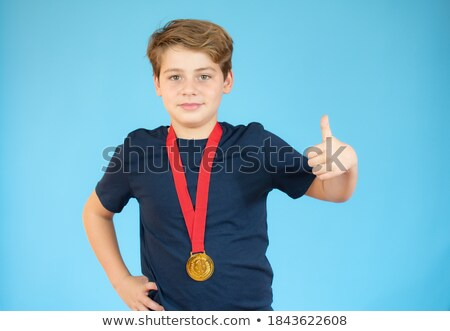 Boy wearing medals Stock photo © soupstock