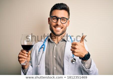 Happy man thumbs up wine stock photo © lovleah