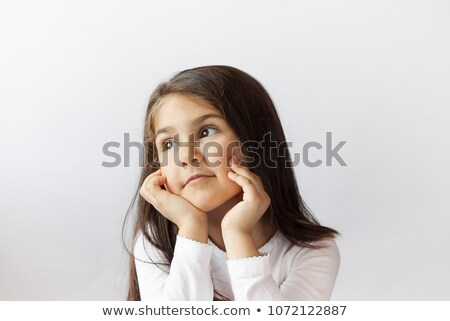 Thoughtful young girl. stock photo © lithian