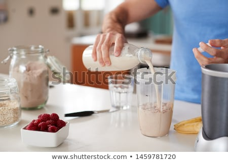 whey protein and almond milk Stock photo © PixelsAway