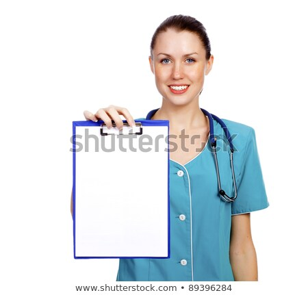 Cute nurse shows a blank paper sheet on clipboard Stock photo © Nobilior