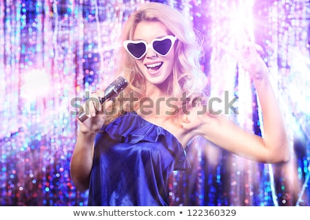 Stock photo: Portrait of a glamorous girl at stage singing and dancing