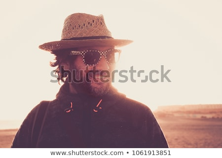 summer portrait of beautiful woman wearing hat vacation at warm stock photo © hasloo