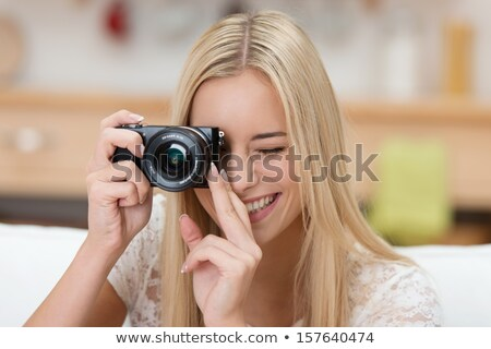 pretty female photographer with her digital camera stock photo © lightpoet