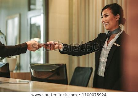Uśmiechnięty recepcjonista uśmiech Internetu pracy tle Zdjęcia stock © photography33