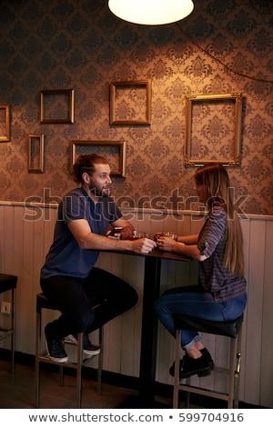 Brunette bar kruk portret mooie jonge Stockfoto © zastavkin