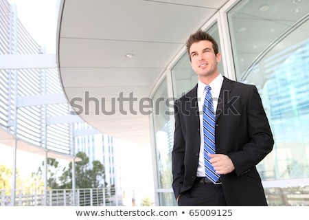 good looking smiling businessman businessperson portrait outdoor stock photo © adamr