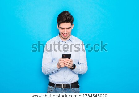 Young casual man reading an sms stock photo © feedough