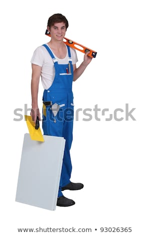 young tradesman posing with his tools and materials stock photo © photography33
