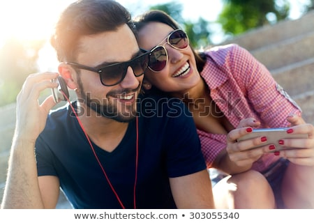 Couple listening to music on telephone Stock photo © photography33