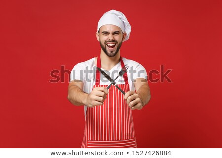 chef in uniform holding a knife and fork stock photo © photography33