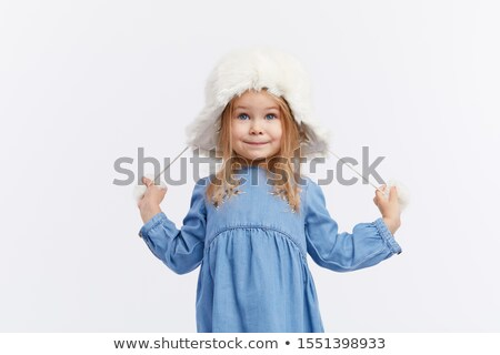 Little fashionable girl in warm clothes stock photo © stockyimages