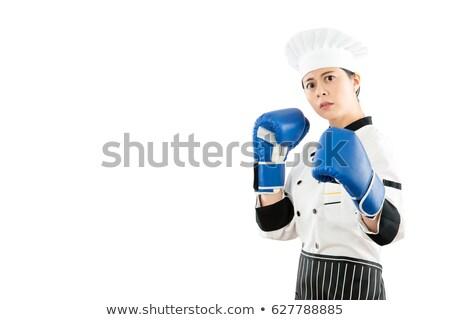 Stockfoto: Female Boxer Ready To Fight Against A White Background