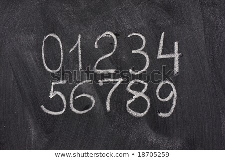 arabic numerals on a blackboard stock photo © pixelsaway