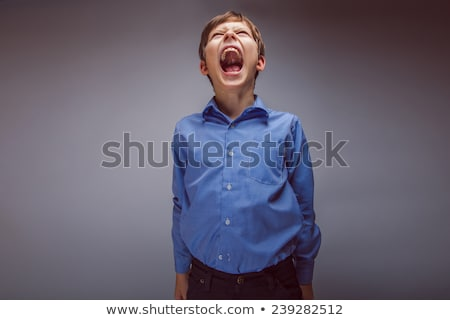 A boy screaming loud with mouth wide open  Stock photo © dacasdo