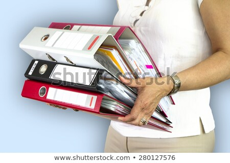 Business Woman HoldingOnto File stock photo © eldadcarin