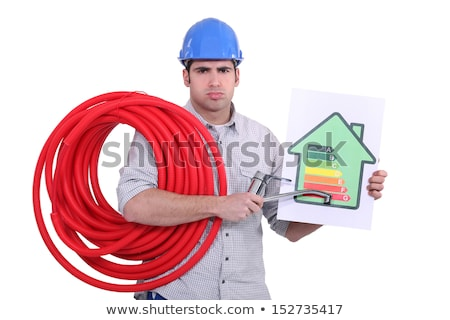 Grumpy man giving a property an energy efficiency rating of G Stock photo © photography33
